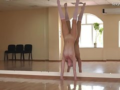 Ballerina strips and shows off her flexible body